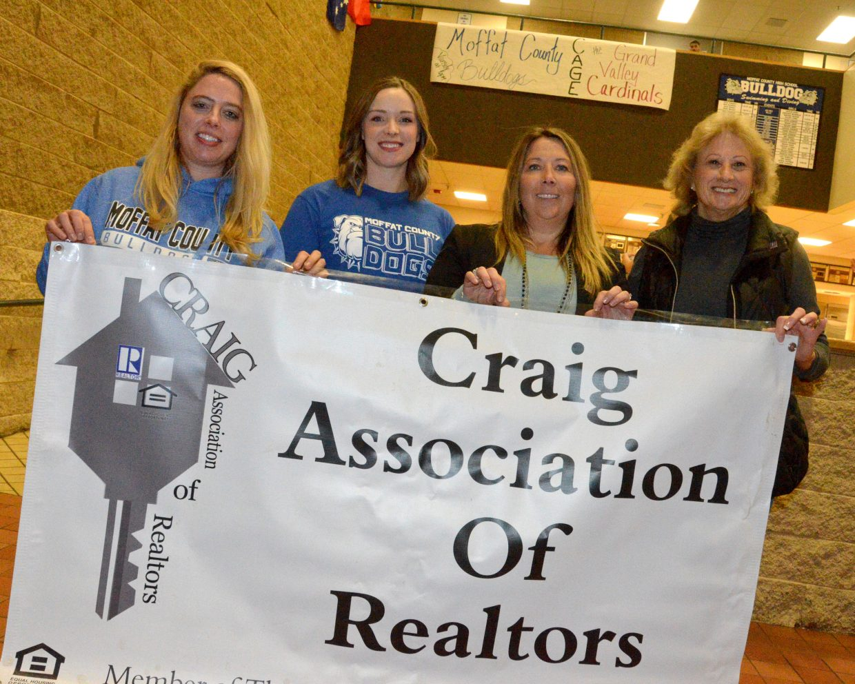Craig Association of Realtors, who paid crowd admission for Friday's Moffat County High School basketball games, display their banner.