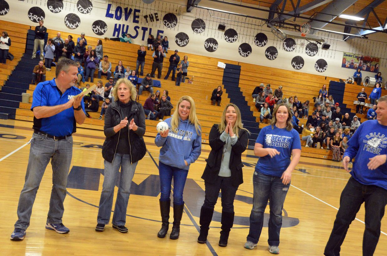 Moffat County High School Athletic Director Bobby Howard is joined by Craig Association of Realtors, who paid crowd admission for Friday's basketball games.