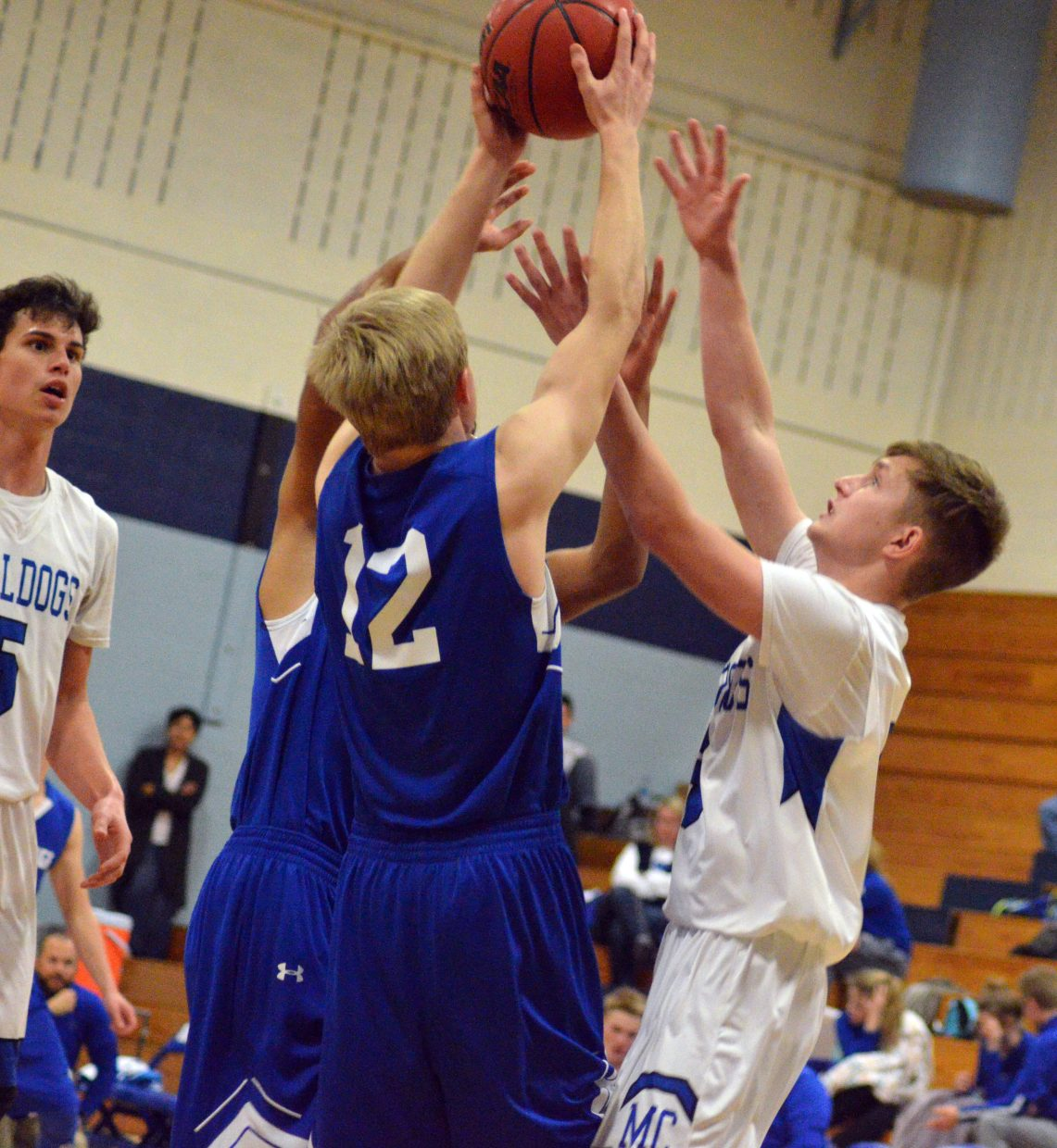 Moffat County High School's Brendan Beaver fights for a rebound.