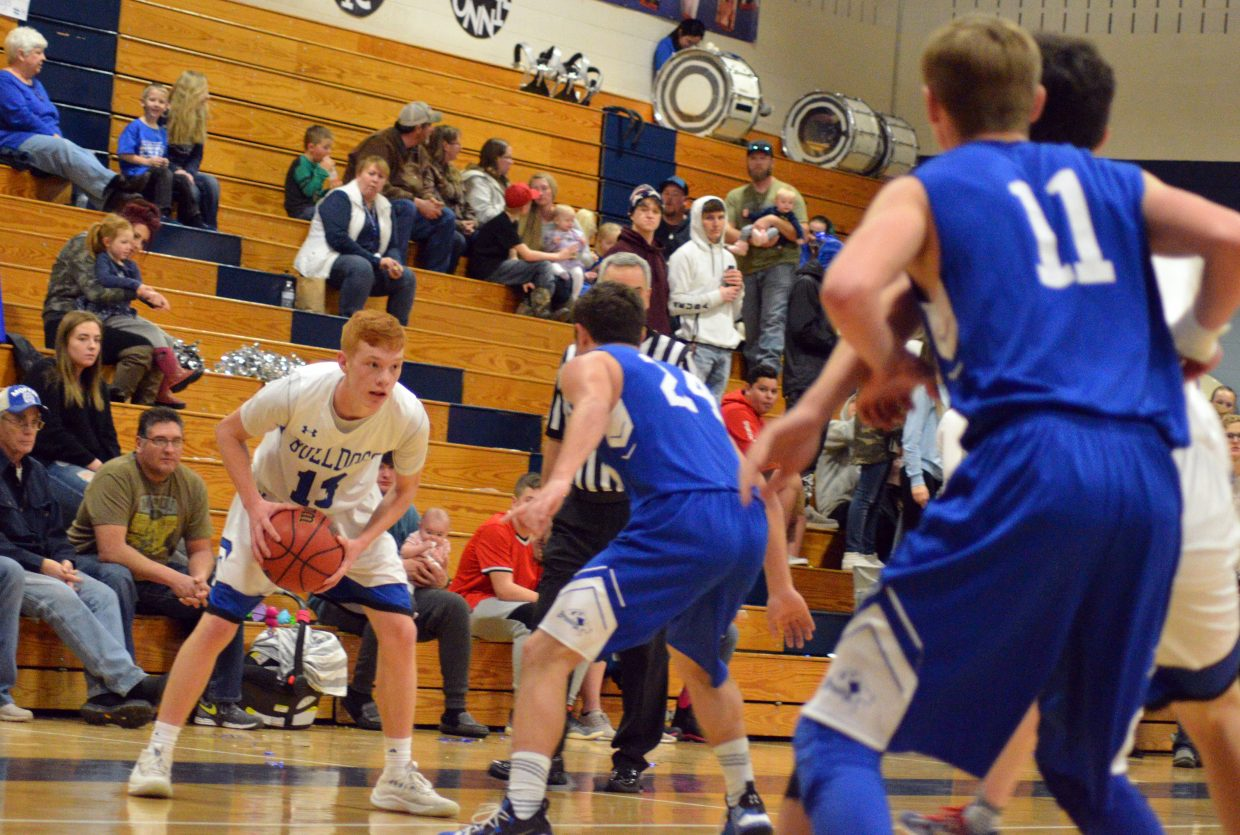 Moffat County High School's Torin Reed eyes a route to the hoop.