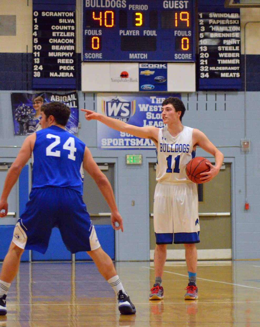Moffat County High School's Connor Murphy directs teammates.