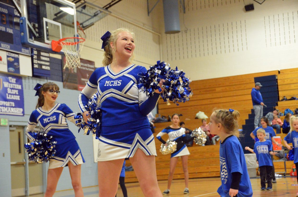 Members of the Moffat County High School Junior Cheer Clinic are led by MCHS cheerleaders.