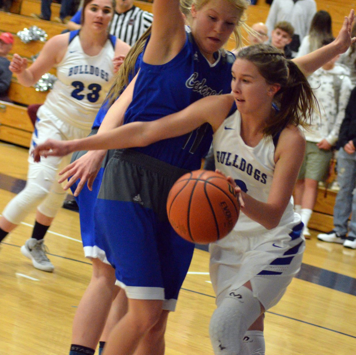 Moffat County High School's Emaleigh Papierski  sticks close to the baseline.