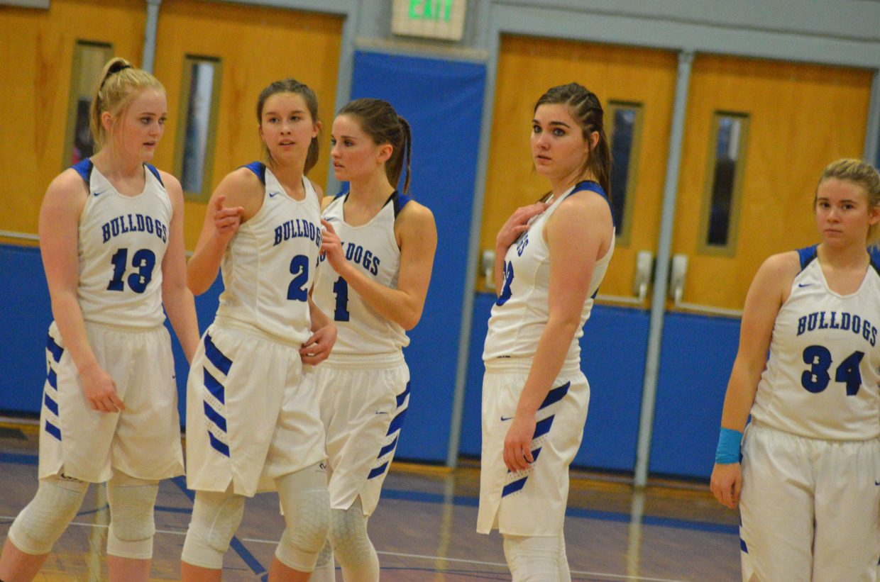 From left, Moffat County High School's Jaidyn Steele, Emaleigh Papierski, Stephenie Swindler, Jenna Timmer and Brittnee Meats head back onto the court after a timeout.