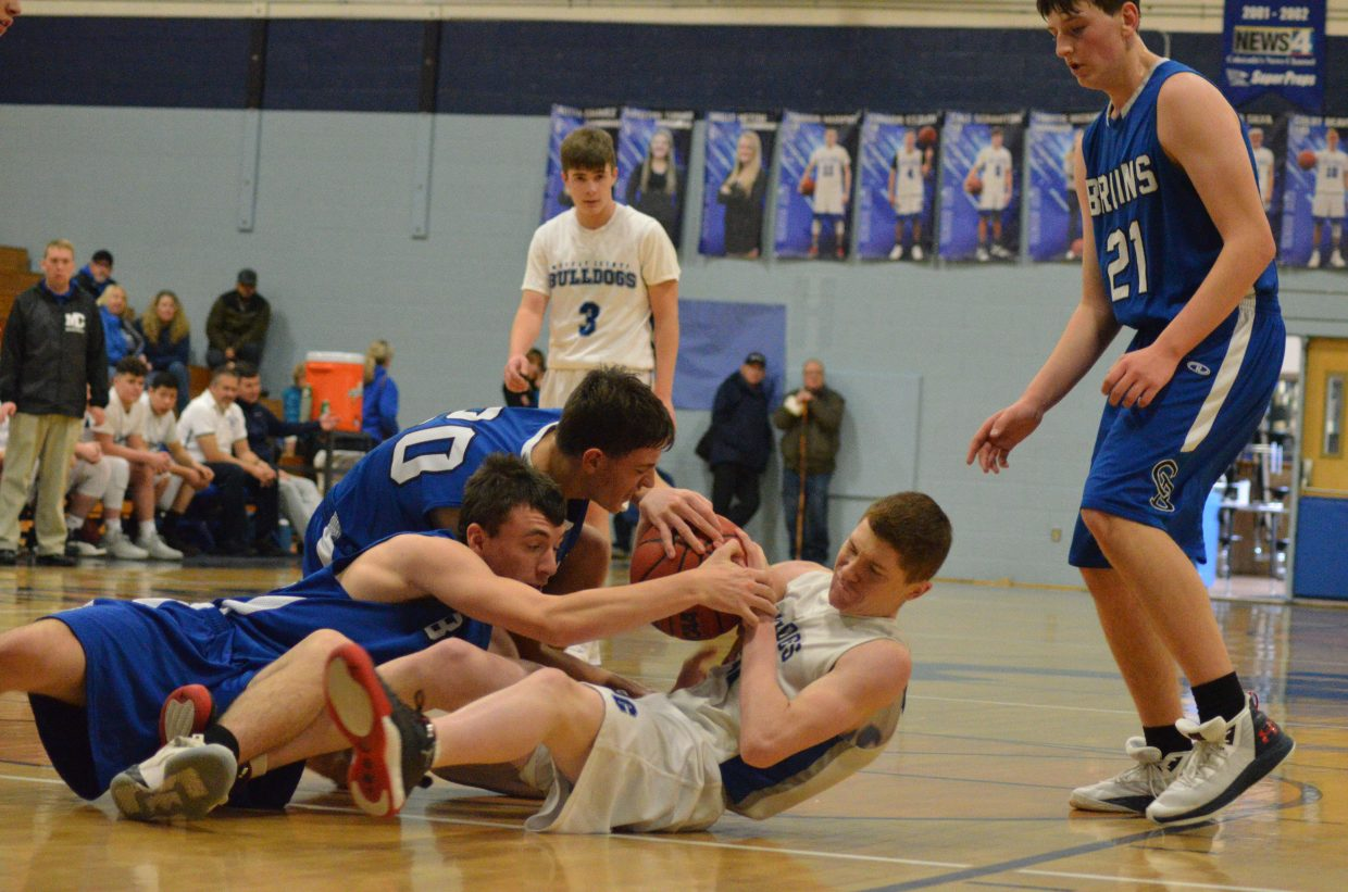 Moffat County High School's Josh Townsend refuses to give up possession during boys JV basketball