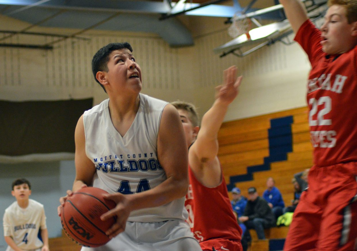 Moffat County High School's Hector Salazar pulls down a rebound and looks for a second-chance shot during Bulldog C-Team's Saturday home tournament.