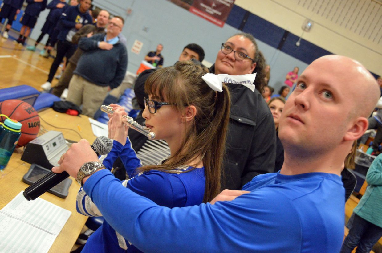 Moffat County High School flautist Abigail Hall performs the national anthem during Saturday's basketball games.