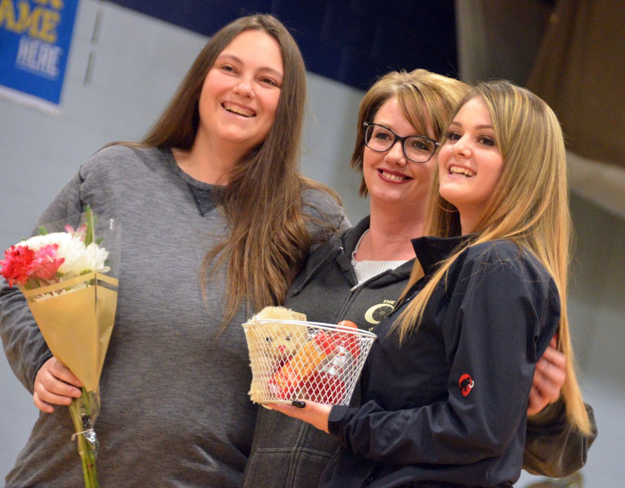 Moffat County High School boys basketball team manager Trinitie Beckner is honored during Senior Night Saturday.