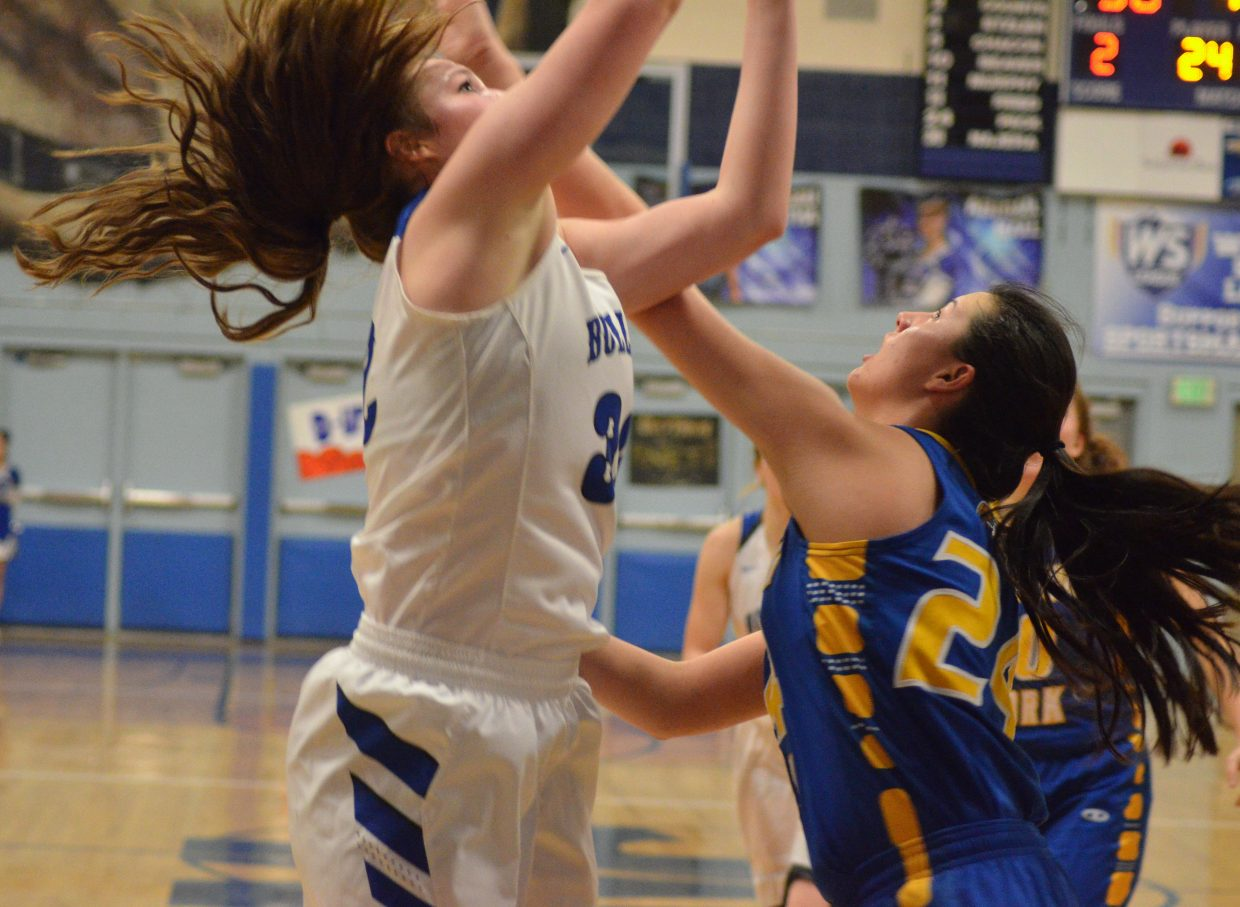 Moffat County High School's Tiffany Hildebrandt steps in and shoots quickly against Roaring Fork.