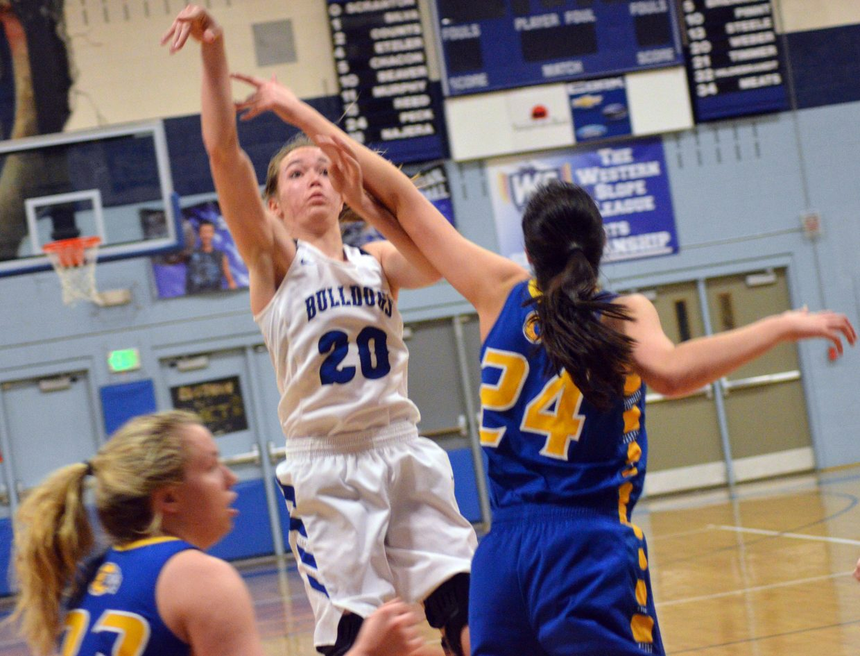 Moffat County High School's Madie Weber unleashes a shot against Roaring Fork.