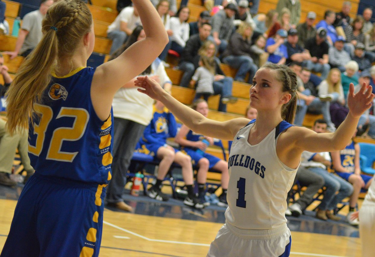 Moffat County High School's Stephenie Swindler makes things difficult for the Roaring Fork inbound.