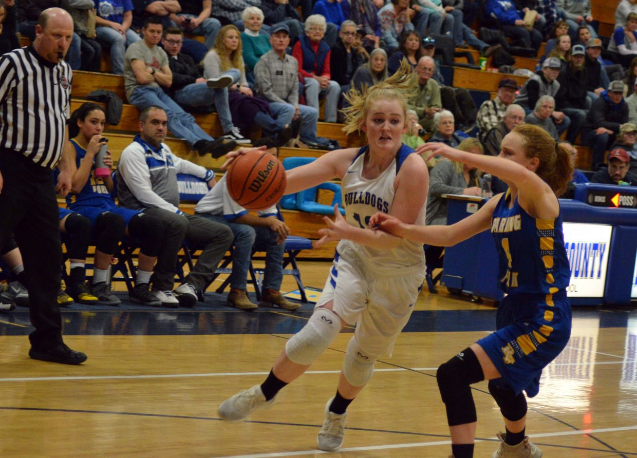 Moffat County High School's Jaidyn Steele drives into the paint against Roaring Fork.