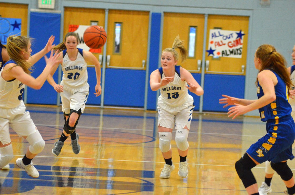 Moffat County High School's Jaidyn Steele foists off the ball after a steal against Roaring Fork.