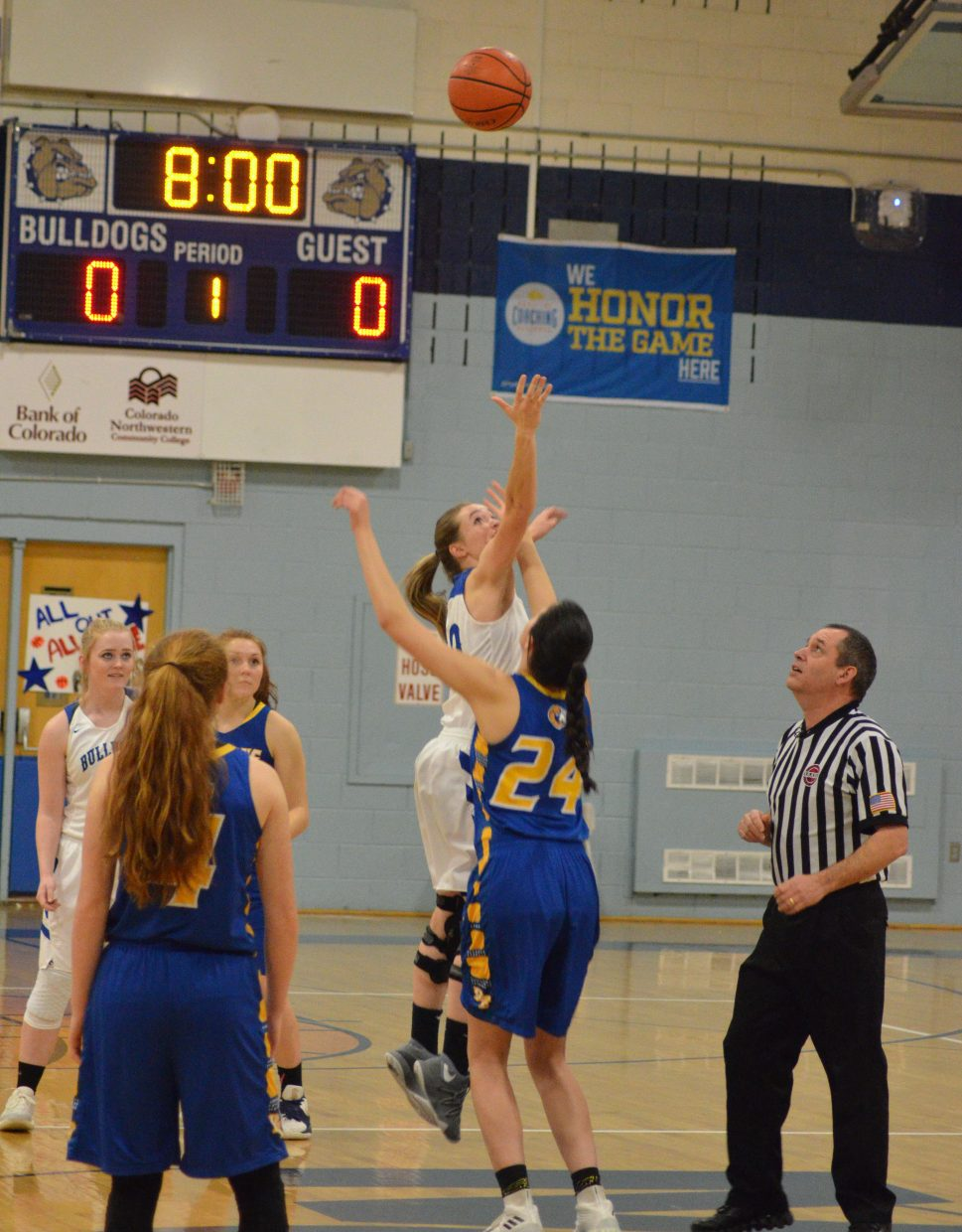 Moffat County High School's Madie Weber gets a jump on the opening tipoff against Roaring Fork.