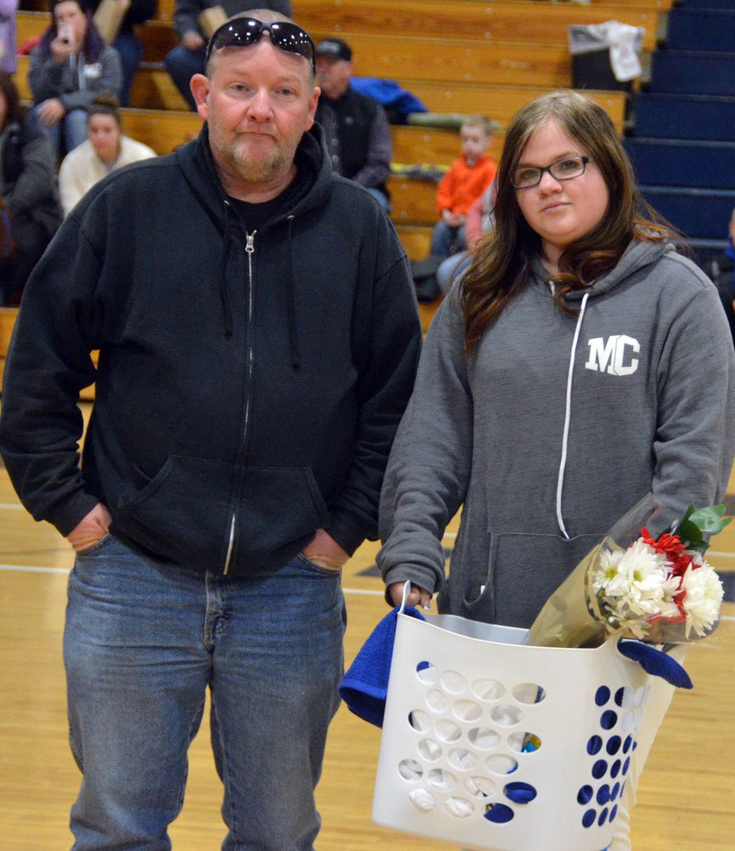 Moffat County High School girls basketball team manager Michelle Shingleton is honored during Senior Night Saturday.