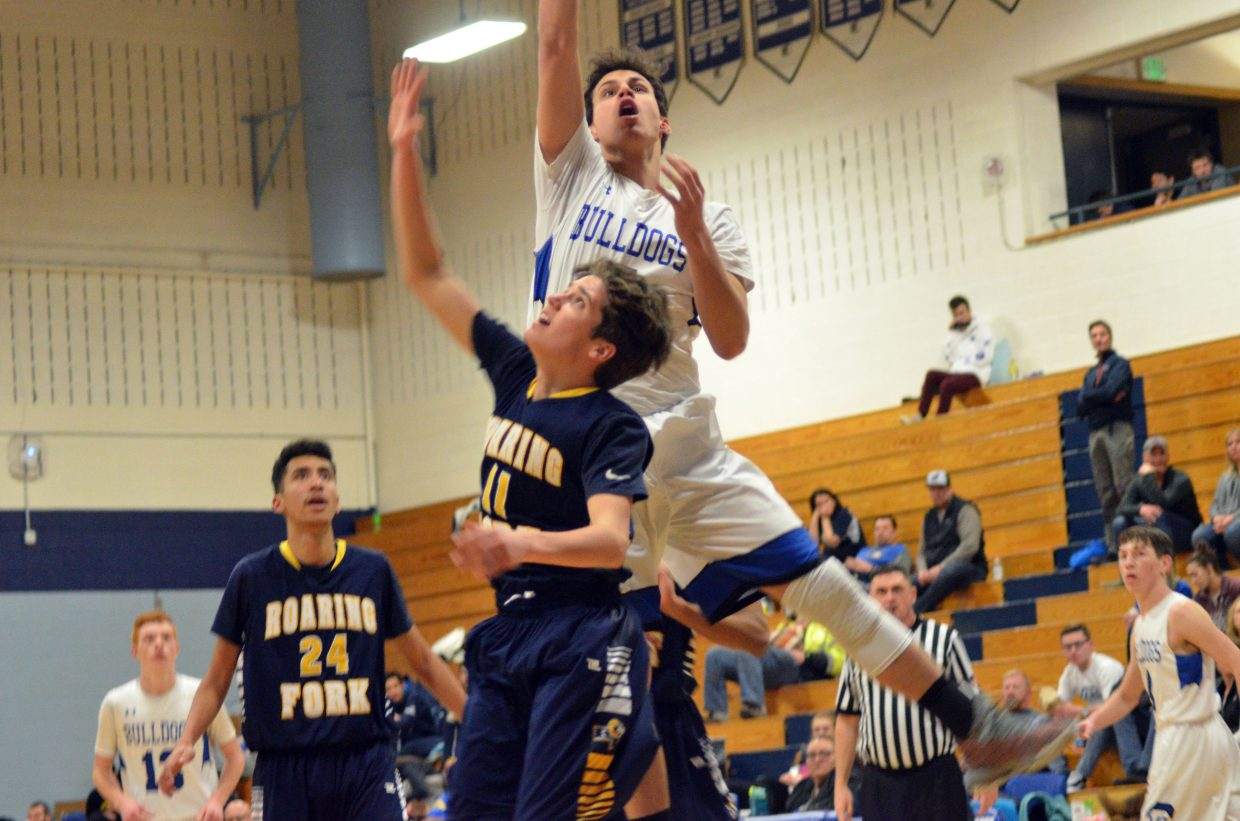 Moffat County High School's Jerod Chacon gets a good jump and a shot off against Roaring Fork.