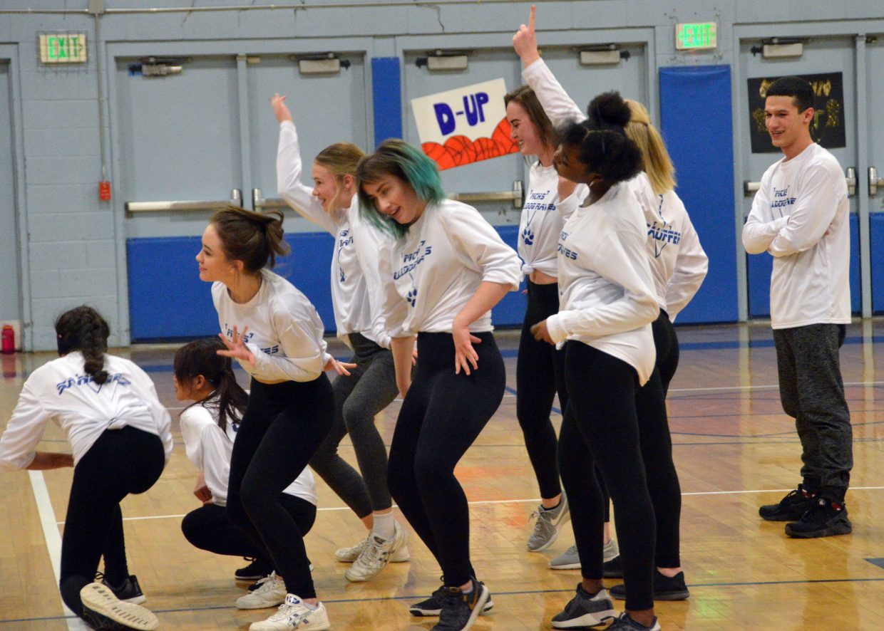 The Moffat County High School Rave Dance Team boogies down at halftime.