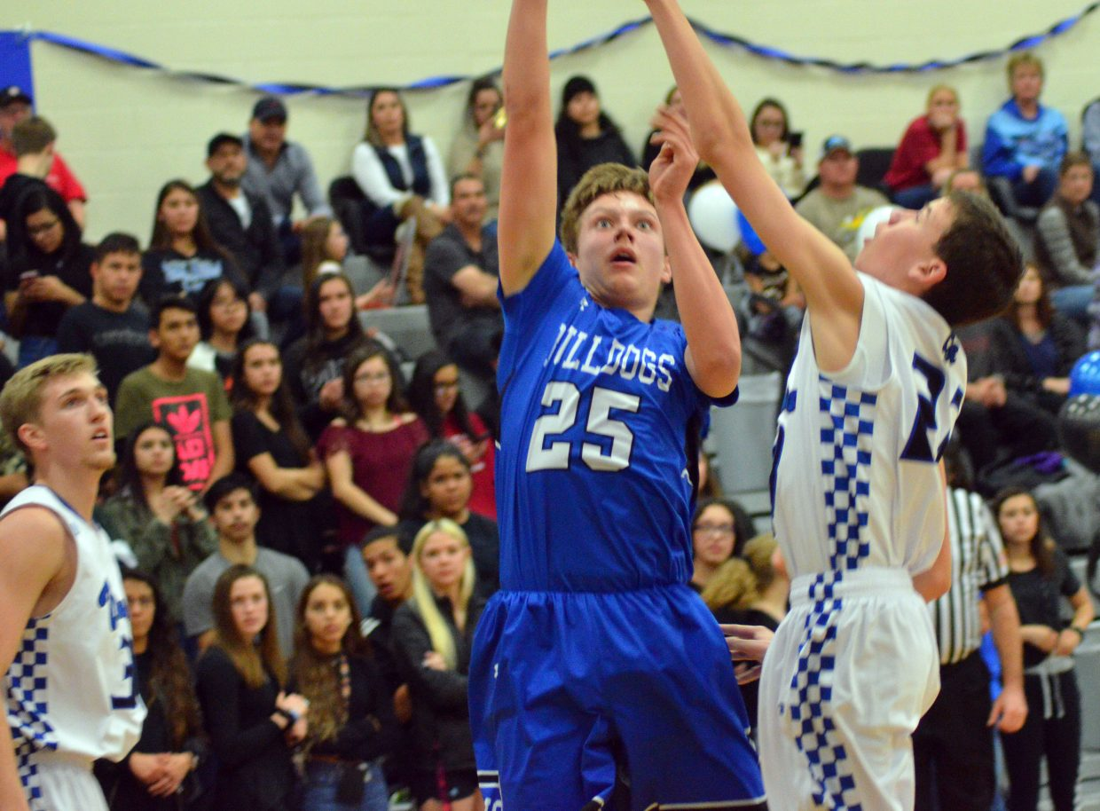 Moffat County High School's Ryan Peck takes a fadeaway shot against Coal Ridge.