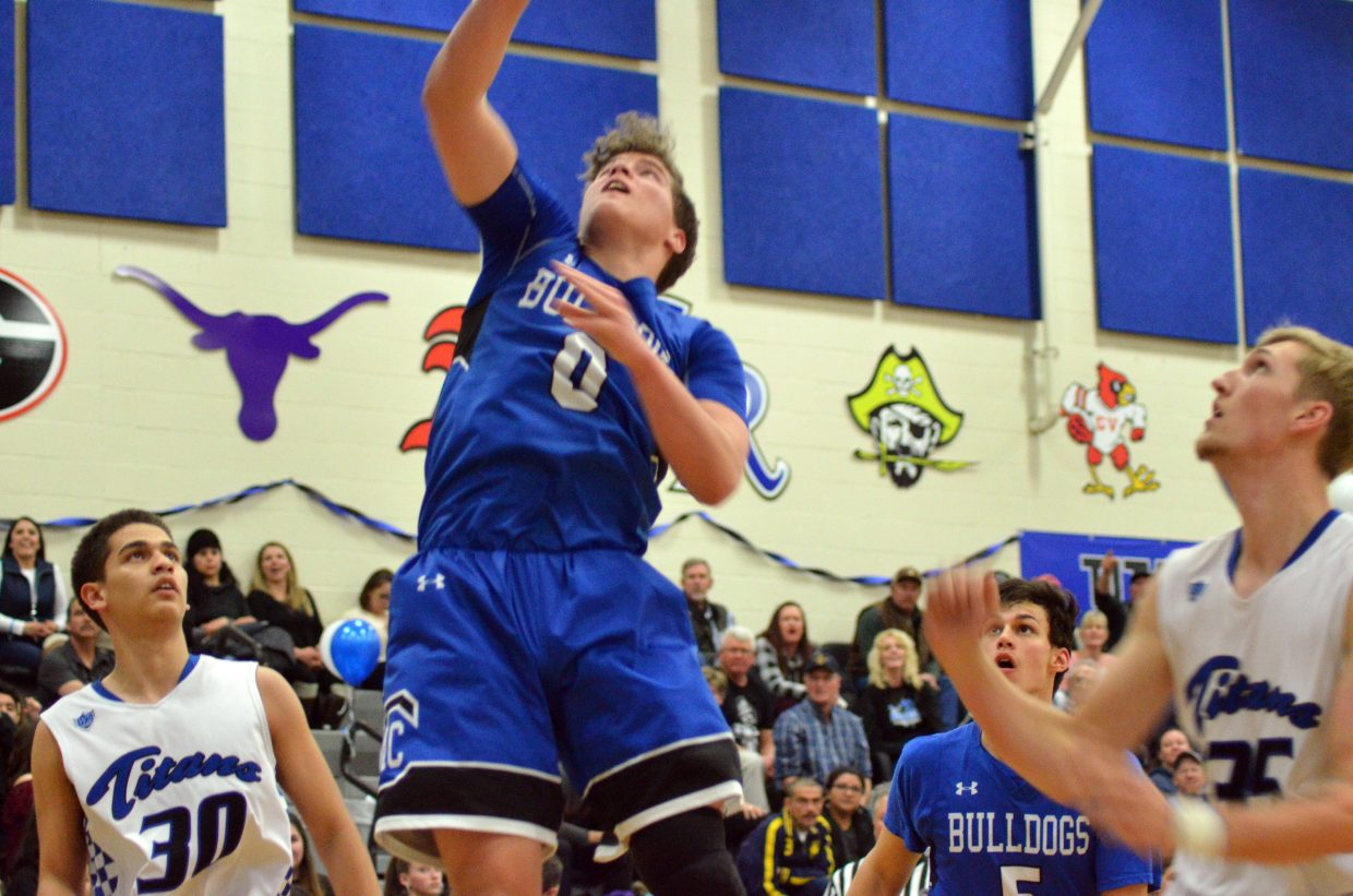 Moffat County High School's Cale Scranton shoots a jumper against Coal Ridge.