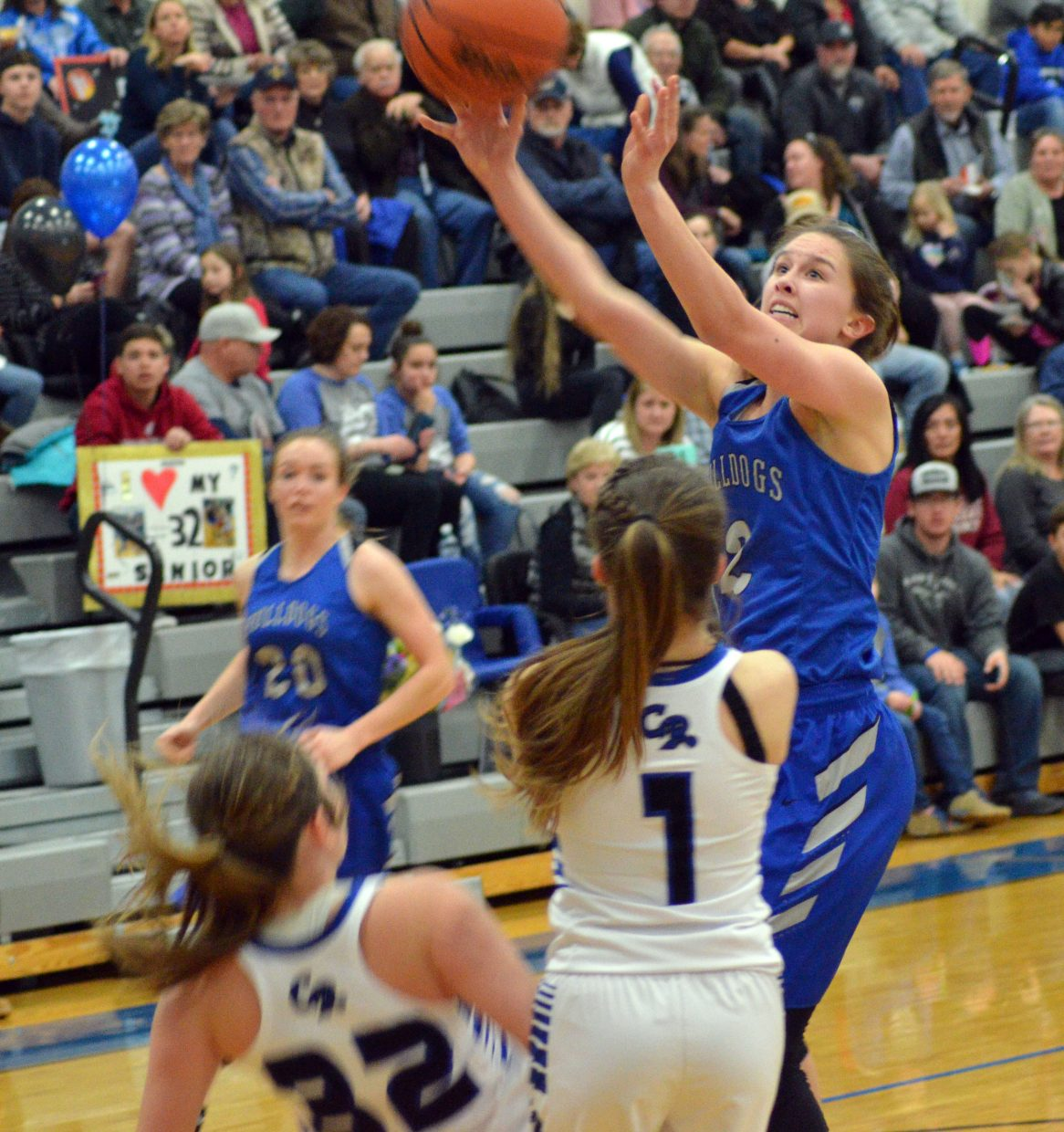 Moffat County High School's Emaleigh Papierski incurs a charge against Coal Ridge.