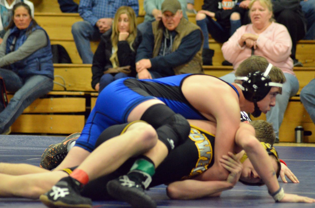 Craig Middle School's Billy Lawton works for a pin against Meeker.