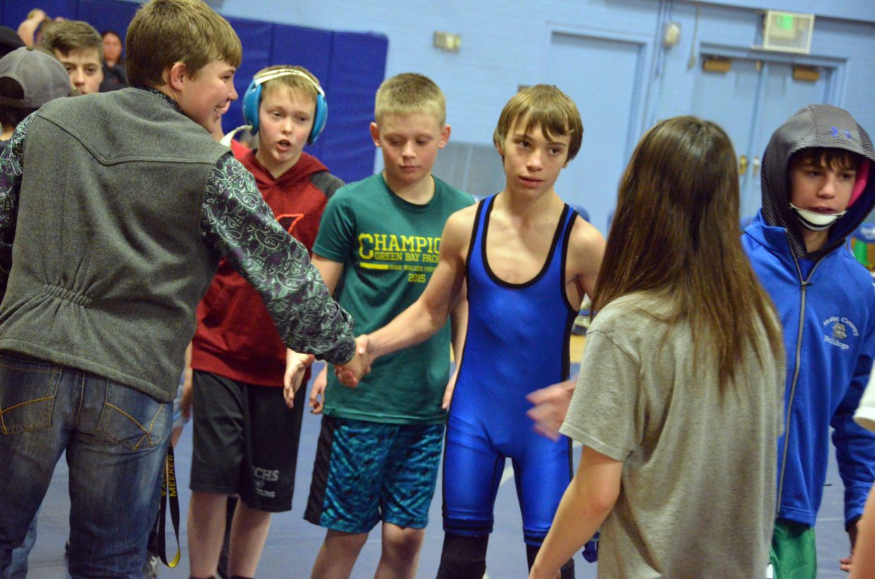 Craig Middle School wrestlers line up to congratulate Meeker opponents following a match Tuesday.