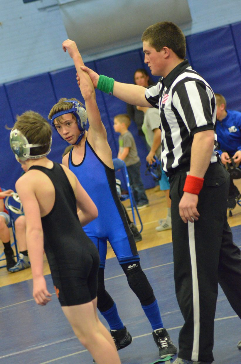 Craig Middle School's Brody Wiser has his arm raised following a win against Hayden.