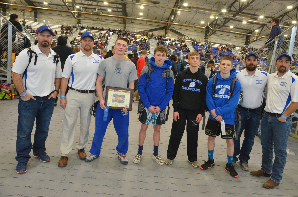 Moffat County High School wrestling coaches join their state placers following the 3A Region 1 Tournament. From left, coach Dusty Vaughn, coach Jarrett Caddy, Daniel Caddy, Dagan White, Hunter Fredrickson, Anthony Duran, coach Kurt Kostur and coach Anton Fredrickson.