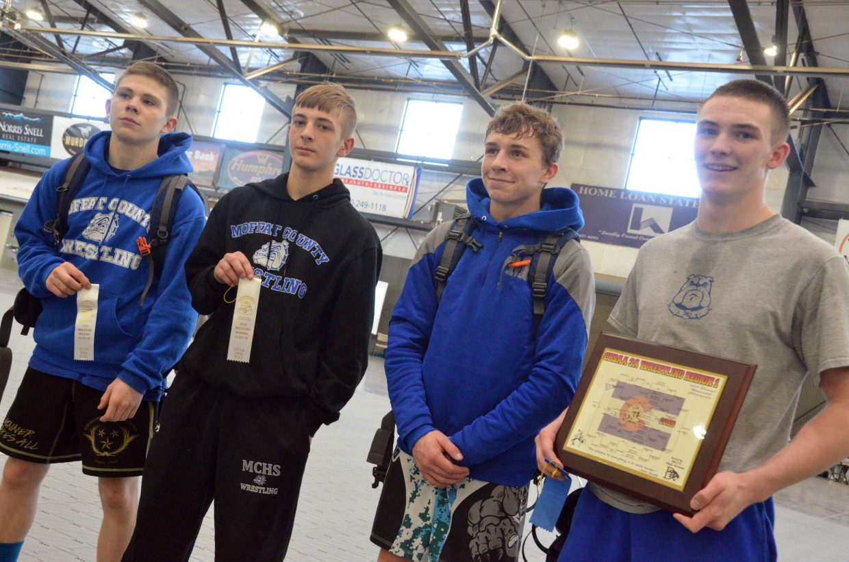 From left, Moffat County High School wrestling state placers Anthony Duran, Hunter Fredrickson, Dagan White and Daniel Caddy gather following the 3A Region 1 Tournament.