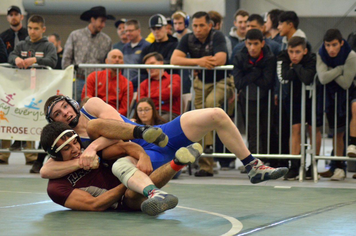 Moffat County High School's Daniel Caddy leans into a hold against Alamosa's Tyler Kenison during the 3A Region 1 Tournament.