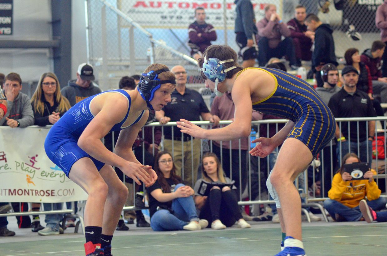 Moffat County High School's Isiaih Herod squares up against Cauy Smith of Rifle during the 3A Region 1 Tournament.