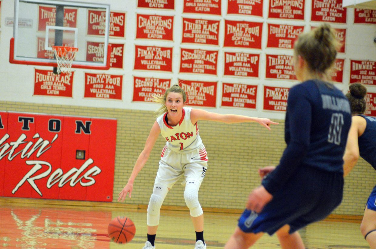 Moffat County High School's Kinlie Brennise motions to teammates to get in position against University.