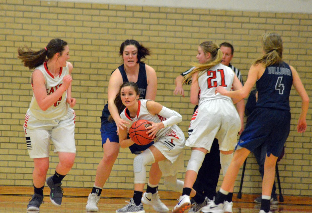 Moffat County High School's Stephenie Swindler snatches away the ball from University.