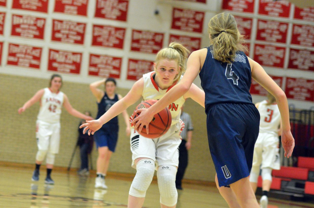 Moffat County High School's Jaidyn Steele stays on the defensive against University.