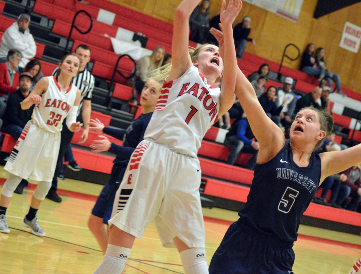 Moffat County High School's Kinlie Brennise puts up a quick shot against  University.