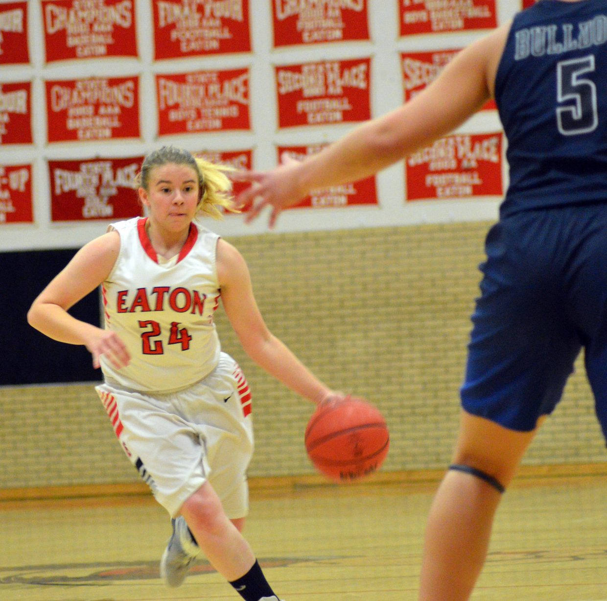 Moffat County High School's Brittnee Meats gets the ball moving against University.