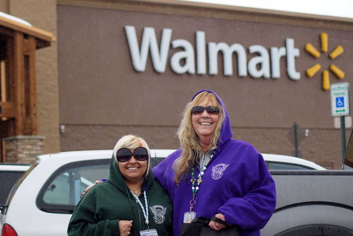 Shoppers driving to Craig Walmart wearing their seat belts Sunday, March 10, were rewarded with swag given out by Colorado State Patrol Communications officers, including dispatcher Isabel Valdez, left, and supervisor Carlene Sanders.