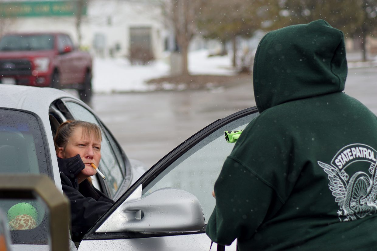 At first, Diana Gray, left, wasn't sure what to think when dispatcher Isabel Valdez approached her car in the Walmart parking lot  Sunday, but both ladies were soon smiling.