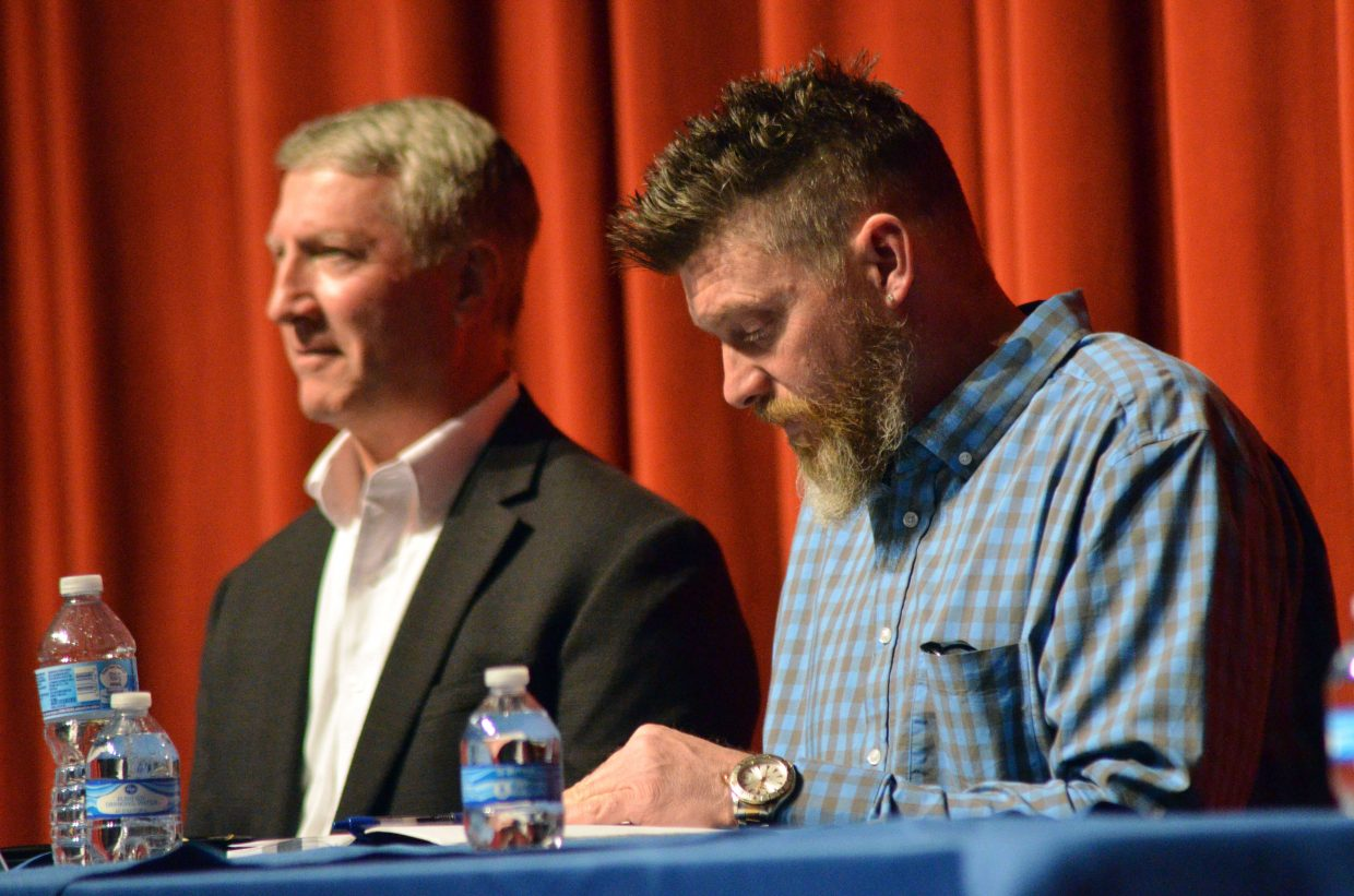 Craig mayoral candidates John Ponikvar, left, and Jarrod Ogden gather their thoughts leading up to Tuesday's election forum.