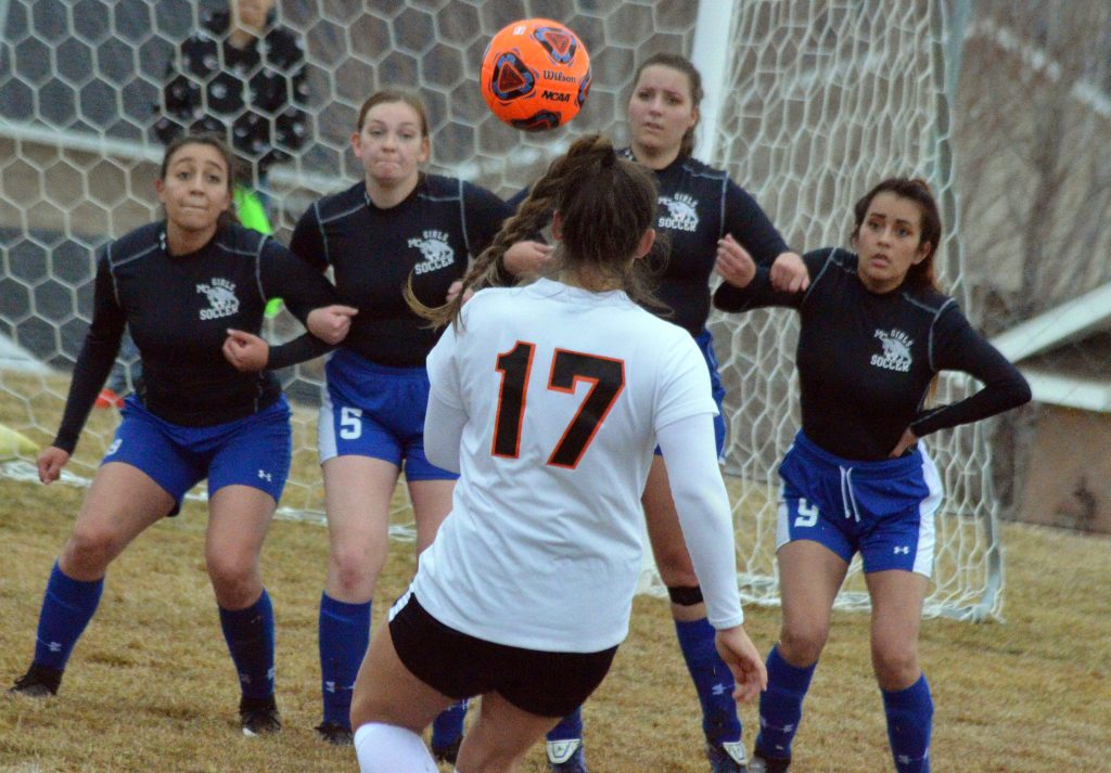 From left, Moffat County High School's Jackie Barraza, Terry Gillett, Ebawnee Smercina and Naomi Torres link up to block a free kick by Grand Junction.