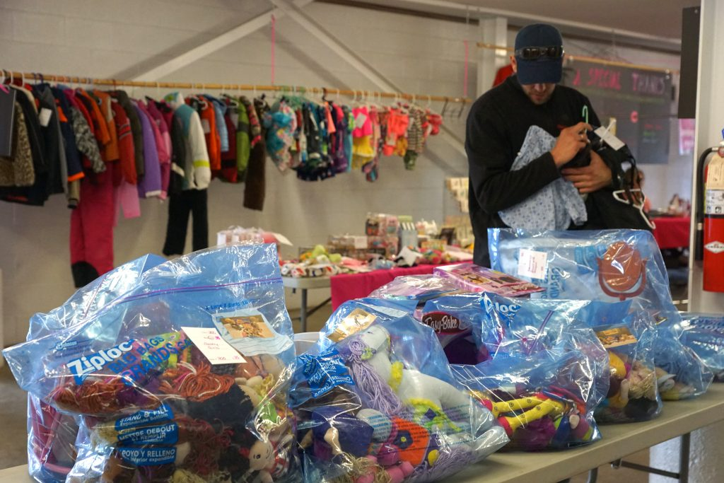 Louis Nijsten shops clothing and toys at the Momma Outfitters sale.