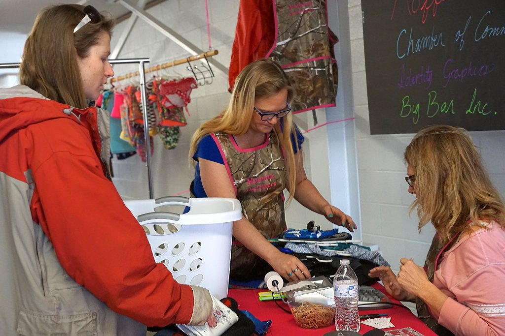 Check out time at the Momma Outfitters consignment sale saw laundry basket shopping carts unloaded and bags and boxes filled.